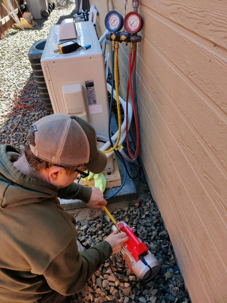 Air conditioner getting repaired by technician