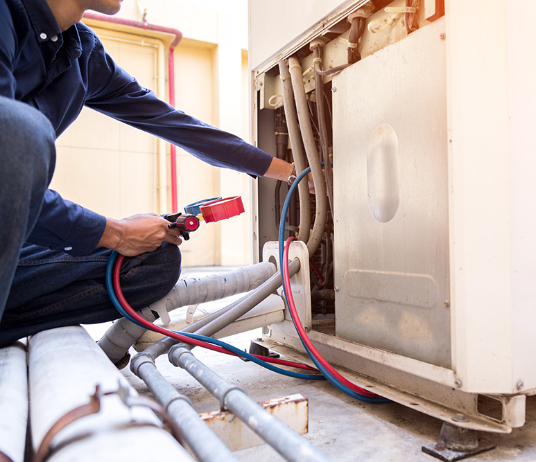 Commercial Air conditioner being repaired by tech