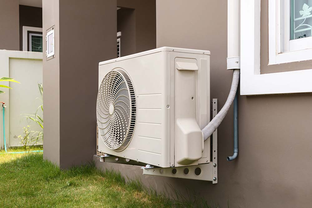 ductless air conditioner on stucco house